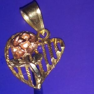14k heart with a rose in the center